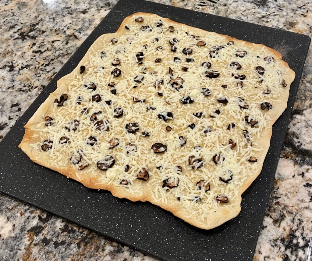 Black Truffle Pizza on Truffle Sourdough Cracker Crust