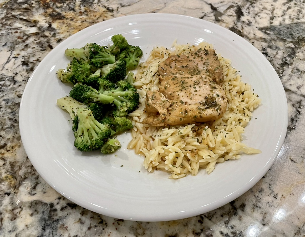 Dill chicken thighs over orzo with garlic roasted broccoli.